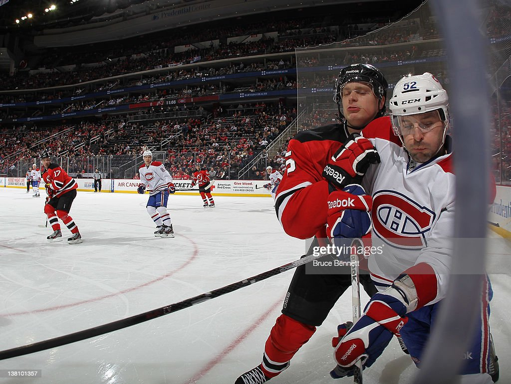 purchase cheap d3d19 2abfa Adam Larsson of the New Jersey Devils hits Mathieu Darche of ...