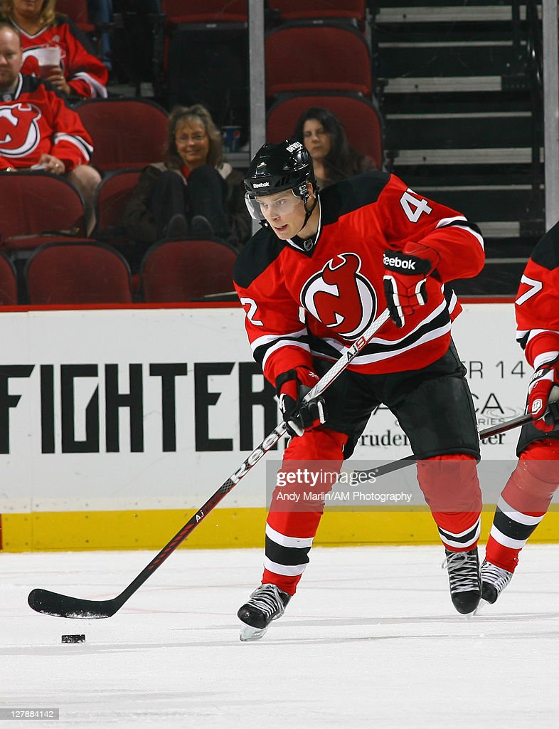cheap for discount 9cb61 e419b Adam Larsson of the New Jersey Devils plays the puck against ...