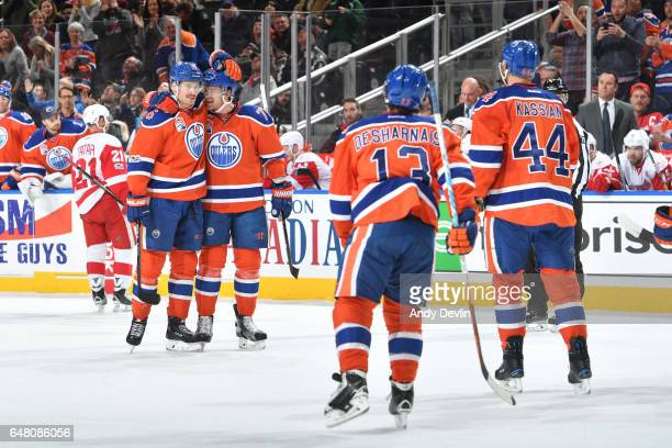 Adam Larsson Oscar Klefbom David Desharnais and Zack Kassian of the Edmonton Oilers celebrate after a goal during the game against the Detroit Red...