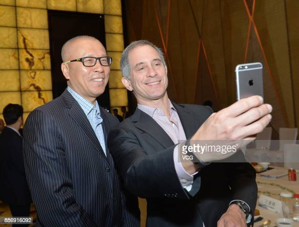 Adam Lashinsky executive chief editor of magazine Fortune takes selfie with a guest at The Morning Tea With Fortune Leaders ahead of the 2017 Fortune...