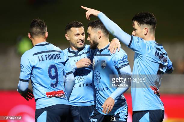 Adam le Fondre Kosta Barbarouses Anthony Caceres and Alexander Baumjohann of Sydney FC celebrate Anthony Caceres scxoring a goal during the round 28...