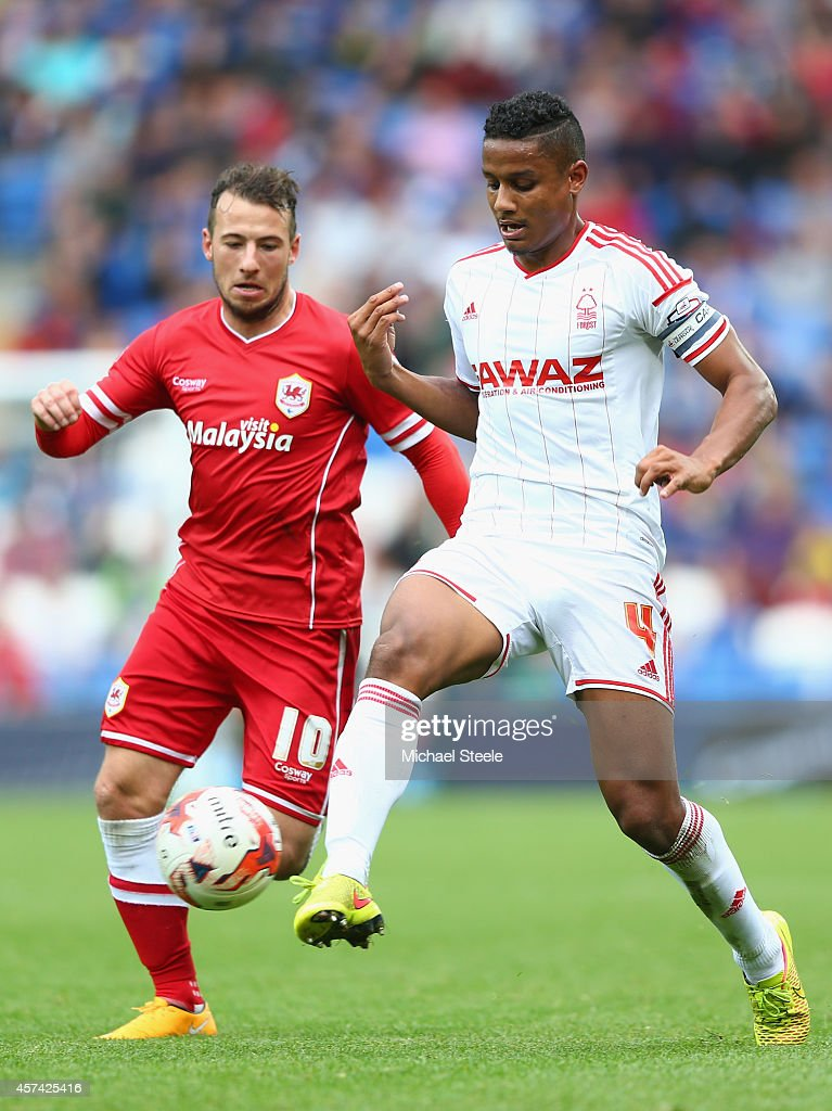 Adam Le Fondre (L) of Cardiff City tracks Michael Mancienne (R) of Nottingham Forest during the Sky Bet Championship match between Cardiff City and Nottingham Forest at Cardiff City Stadium on October 18, 2014 in Cardiff, Wales.