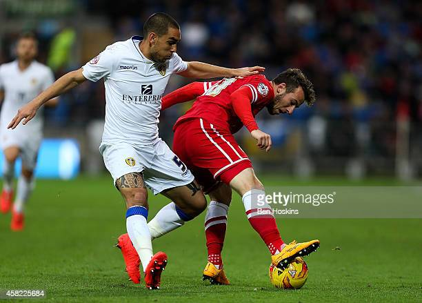 Adam Le Fondre of Cardiff holds off the challenge of Guiseppe Bellusci of Leeds during the Sky Bet Championship match between Cardiff City and Leeds...