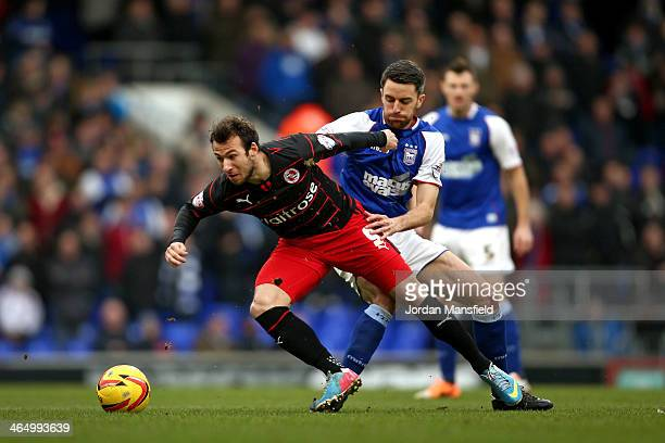 Adam Le Fondre of Reading and Cole Skuse of Ipswich tackle for possession during the Sky Bet Championship match between Ipswich Town and Reading at...