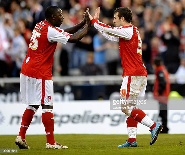 Adam Le Fondre of Rotheram celebrates the first goal with Pablo Mills during the CocaCola League Two Playoff Semi Final 2nd Leg match between...