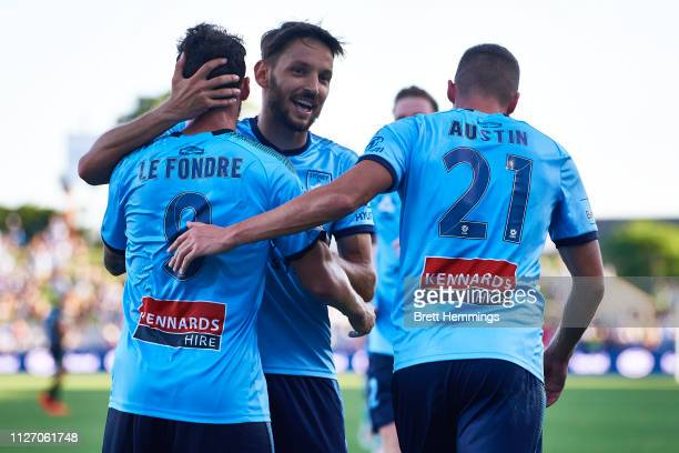 Adam Le Fondre of Sydney celebrates scoring a goal with team mates during the round 17 ALeague match between Sydney FC and Melbourne City at WIN...