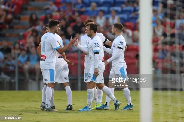 Adam Le Fondre of Sydney FC celebrates a goal with team mates during the round 14 ALeague match between the Newcastle Jets and Sydney FC at McDonald...