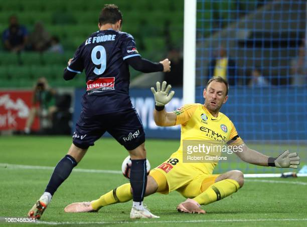 Adam Le Fondre of Sydney FC gets his shot past Melbourne City goalkeeper Eugene Galekovic to score during the round three ALeague match between...