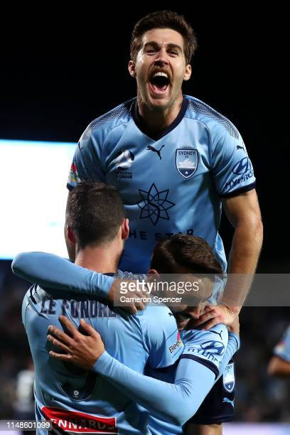 Adam Le Fondre of Sydney FC is congratulated by Milos Ninkovic of Sydney FC and Josh Brillante of Sydney FC after scoring a goal during the A-League...