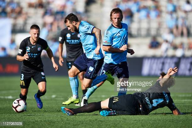 Adam Le Fondre of Sydney is tackled by Harrison Delbridge of Melbourne City during the round 17 ALeague match between Sydney FC and Melbourne City at...