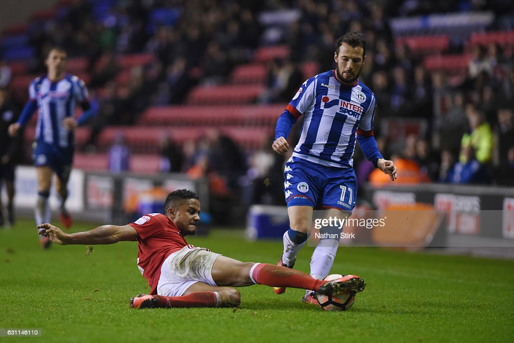 Adam Le Fondre of Wigan Athletic and Michael Mancienne of Nottingham Forest in action during the Emirates FA Cup Third Round match between Wigan Athletic and Nottingham Forest at the DW Stadium on January 7, 2017 in Wigan, England (Photo by Nathan Stirk/Getty Images).