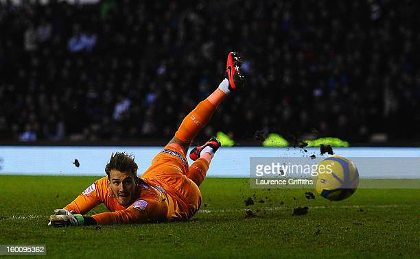 Adam Legzdins of Derby County dives to make a save during the FA Cup with Budweiser Fourth Round match between Derby County and Blackburn Rovers at...