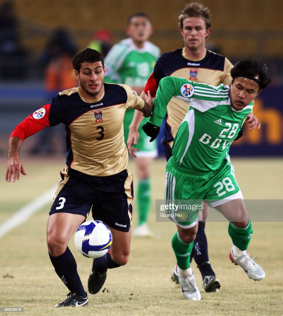 Adam Leonard D'Apuzzo (L) of Newcastle Jets and Guo Hui (R) of Beijing Guoan fight for a ball during the AFC Champions League Group E match between Beijing Guoan and the Newcastle Jets at Beijing Worker's Stadium on March 10, 2009 in Beijing, China.