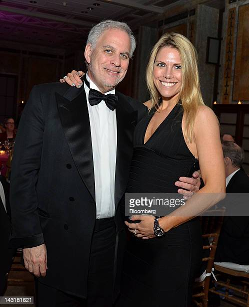 Adam Levin chairman and cofounder of Creditcom Inc and wife Heather Levin stand for a photograph at the Municipal Art Society Gala in New York US on...