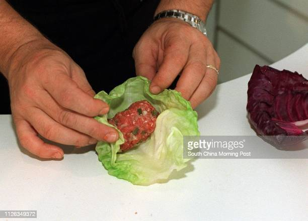 Adam Levin chef of the Bostonian restaurant at the Great Eagle Hotel preparing his dish quotStuffed Cabbage with Sweet and Sour Tomatoesquot in his...