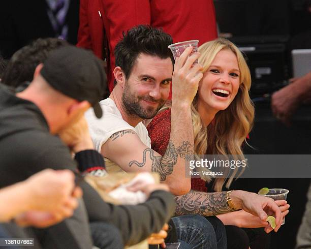 Adam Levine and Anne Vyalitsyna attend the Los Angeles Lakers vs Chicago Bulls game on December 25 2011 in Los Angeles California