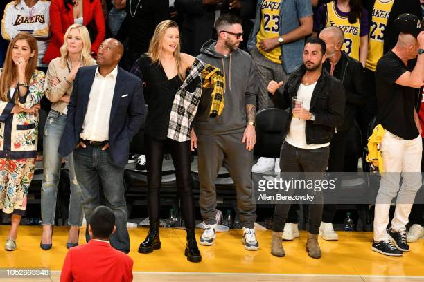 Adam Levine and Behati Prinsloo attend a basketball game between the Los Angeles Lakers and the Houston Rockets at Staples Center on October 20 2018...