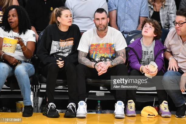 Adam Levine and Behati Prinsloo attend a basketball game between the Los Angeles Lakers and the Dallas Mavericks at Staples Center on December 01,...