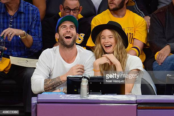 Adam Levine and Behati Prinsloo attend a basketball game between the Houston Rockets and the Los Angeles Lakers at Staples Center on October 28, 2014...