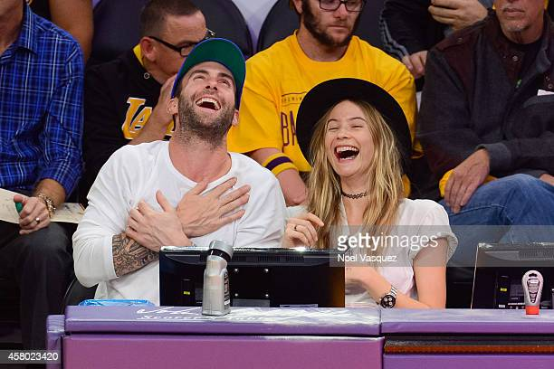 Adam Levine and Behati Prinsloo attend a basketball game between the Houston Rockets and the Los Angeles Lakers at Staples Center on October 28 2014...