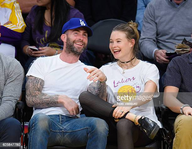 Adam Levine and Behati Prinsloo attend a basketball game between the Golden State Warriors and the Los Angeles Lakers at Staples Center on November...