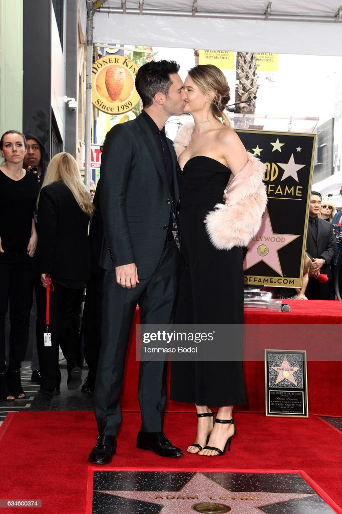 Adam Levine and Behati Prinsloo attend a ceremony honoring Adam Levine with Star On The Hollywood Walk Of Fame on February 10, 2017 in Hollywood, California.