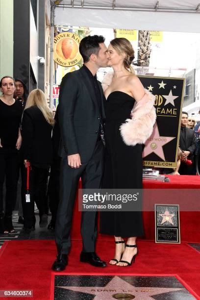 Adam Levine and Behati Prinsloo attend a ceremony honoring Adam Levine with Star On The Hollywood Walk Of Fame on February 10 2017 in Hollywood...