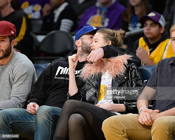Adam Levine and Behati Prinsloo kiss at a basketball game between the Golden State Warriors and the Los Angeles Lakers at Staples Center on November...