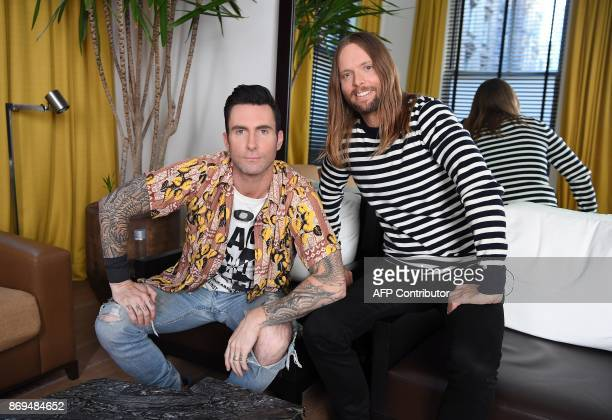 Adam Levine and James Valentine of Maroon 5 pose for pictures in New York on October 31 2017 Tensions may be mounting dangerously around the world...