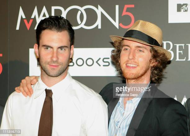 """Adam Levine and Jesse Carmichael of Maroon 5 during Maroon 5 Launches Their Book """"Midnight Miles"""" at Miau Haus Art Studio in Los Angeles, California,..."""