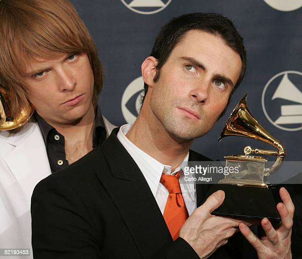 Adam Levine and Jesse Carmichael of Maroon 5 pose backstage with their award for Best New Artist during the 47th Annual Grammy Awards at the Staples...
