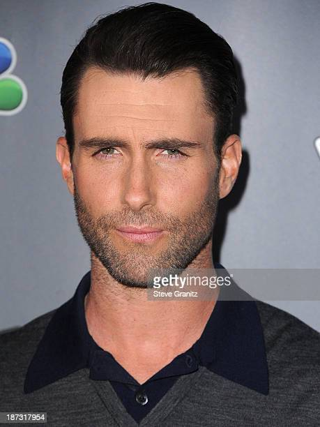 Adam Levine arrive at the 'The Voice' Season 5 Top 12 Red Carpet Event at Universal Studios Hollywood on November 7 2013 in Universal City California