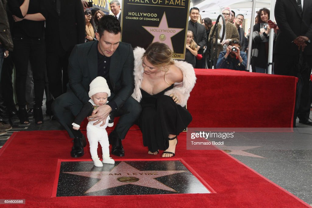 Adam Levine, Behati Prinsloo and Dusty Rose Levine attend a ceremony honoring Adam Levine with Star On The Hollywood Walk Of Fame on February 10, 2017 in Hollywood, California.