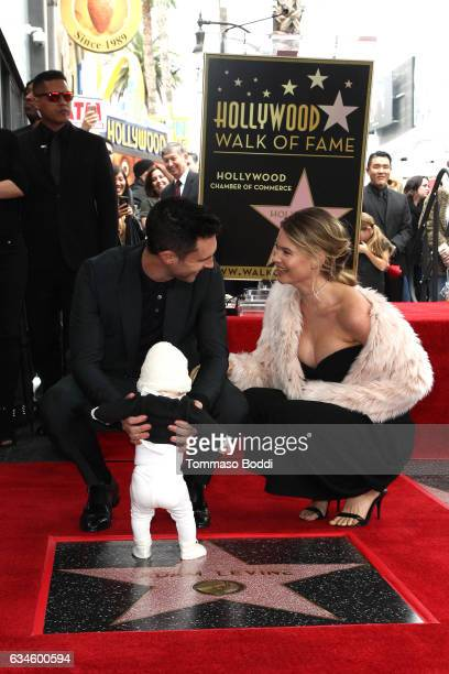 Adam Levine Behati Prinsloo and Dusty Rose Levine attend a ceremony honoring Adam Levine with Star On The Hollywood Walk Of Fame on February 10 2017...