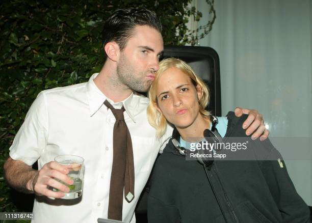 """Adam Levine of Maroon 5 and Samantha Ronson during Maroon 5 Launches Their Book """"Midnight Miles"""" at Miau Haus Art Studio in Los Angeles, California,..."""