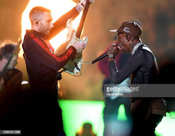 Adam Levine of Maroon 5 and Travis Scott perform during the Pepsi Super Bowl LIII Halftime Show at MercedesBenz Stadium on February 3 2019 in Atlanta...