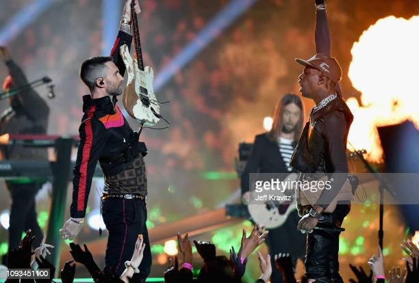 Adam Levine of Maroon 5 and Travis Scott perform during the Pepsi Super Bowl LIII Halftime Show at MercedesBenz Stadium on February 3 2019 in Atlanta...
