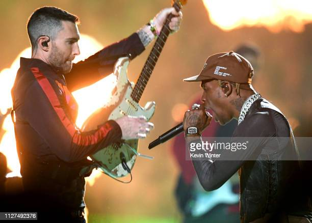 Adam Levine of Maroon 5 and Travis Scott perform during the Pepsi Super Bowl LIII Halftime Show at Mercedes-Benz Stadium on February 03, 2019 in...