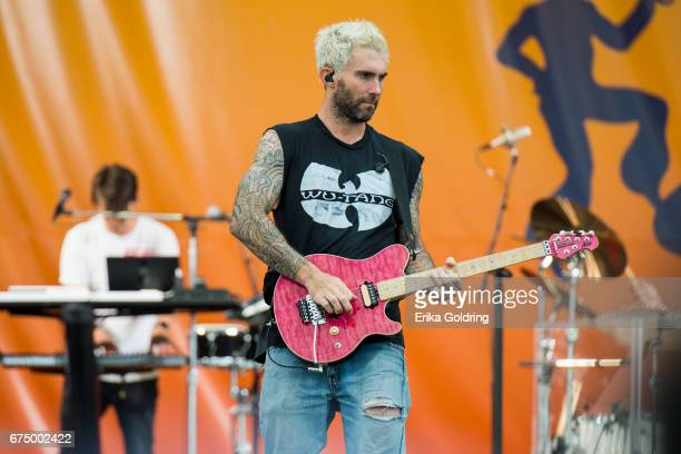 Adam Levine of Maroon 5 performs during the 2017 New Orleans Jazz Heritage Festival at Fair Grounds Race Course on April 29 2017 in New Orleans...