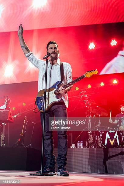 Adam Levine of Maroon 5 performs on stage at LG Arena on January 8 2014 in Birmingham United Kingdom