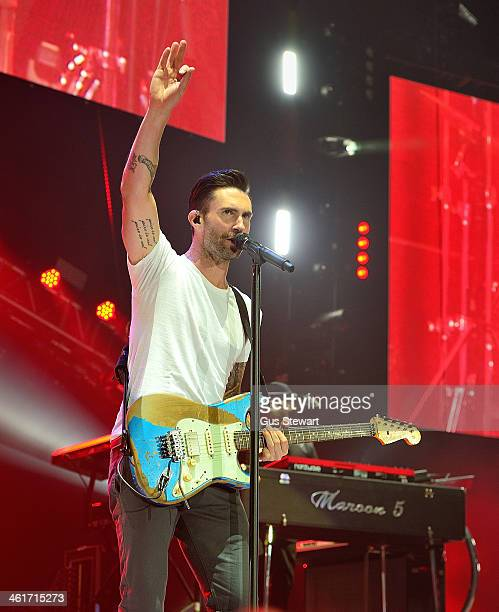 Adam Levine of Maroon 5 performs on stage at O2 Arena on January 10 2014 in London United Kingdom