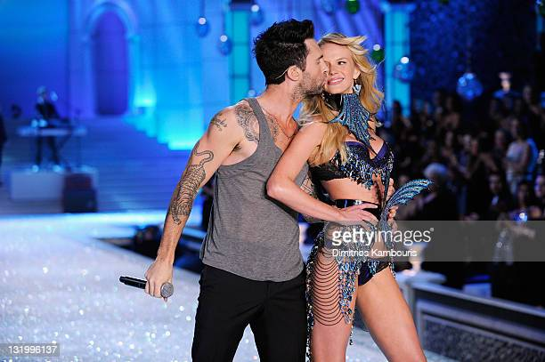 Adam Levine of Maroon 5 performs with Model Anne Vyalitsina during the 2011 Victoria's Secret Fashion Show at the Lexington Avenue Armory on November...