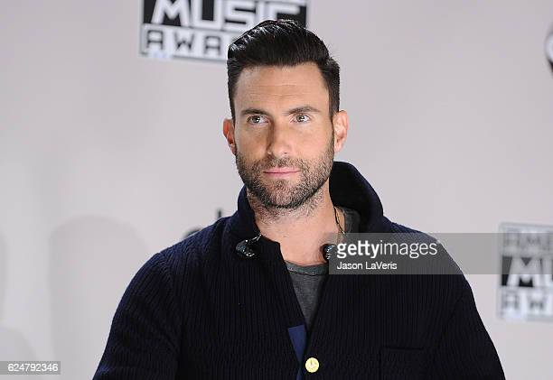 Adam Levine of Maroon 5 poses in the press room at the 2016 American Music Awards at Microsoft Theater on November 20 2016 in Los Angeles California