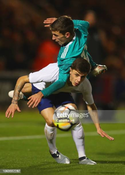 Adam Lewis of England and Benjamin Goller of Germany battle for the ball during the international friendly match between England U20 and Germany U20...