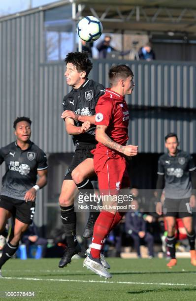 Adam Lewis of Liverpool and Anthony Glennon of Burnley in action during the Premier League Cup game at The Kirkby Academy on November 11 2018 in...