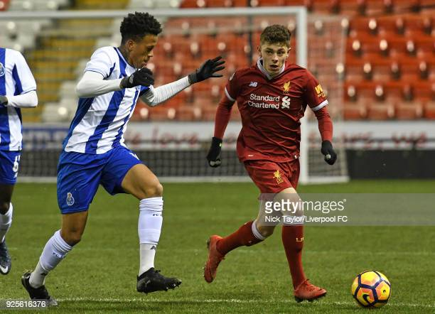 Adam Lewis of Liverpool and Luiz Palhares of Porto in action during the Liverpool v Porto Premier League International Cup game at Leigh Sports...