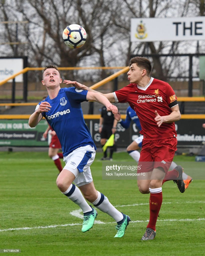 Adam Lewis of Liverpool and Nathan Broadhead of Everton in action during the Everton v Liverpool PL2 game on April 16, 2018 in Southport, England.