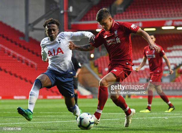 Adam Lewis of Liverpool and Tariq Hinds of Tottenham Hotspur in action during the Liverpool v Tottenham Hotspur PL2 game at Anfield on August 17 2018...