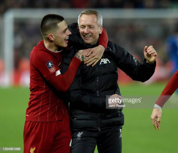 Adam Lewis of Liverpool celebrates with Neil Critchley manager of Liverpool at the end of the FA Cup Fourth Round Replay match between Liverpool FC...