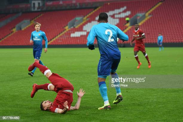 Adam Lewis of Liverpool falls after a challange from Vontae DaleyCampbell of Arsenal during the FA Youth Cup 4th Round match between Liverpool and...